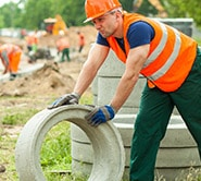 Man Holding Concrete Pipe